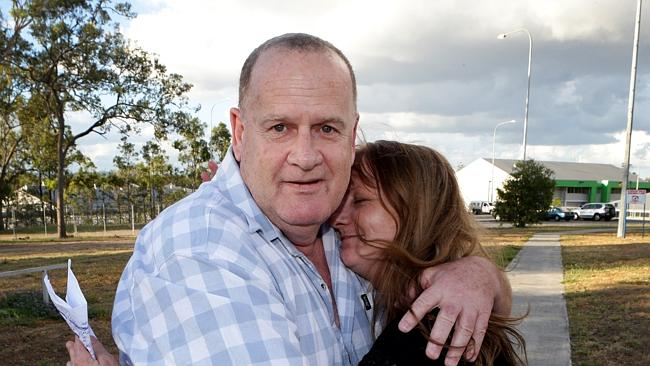 Yandina Five member Paul Lansdowne celebrates being released from jail with his supporter Jasmine Ross. Pic Darren England.