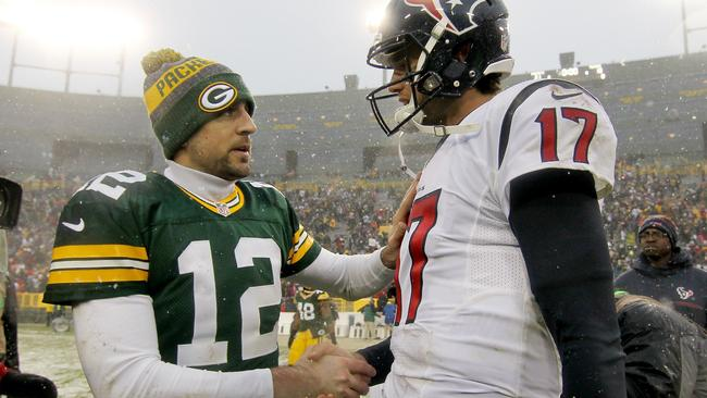 Aaron Rodgers #12 of the Green Bay Packers and Brock Osweiler #17 of the Houston Texans.