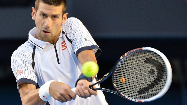 Novak Djokovic hits a backhand in his quarter-final clash Tomas Berdych. Picture: George Salpigtidis