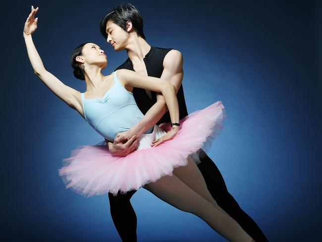 Lord of the dance: Australian Ballet star Chengwu Guo in full flight with his girlfriend Ako Kondo on stage. Picture: Tim Carrafa