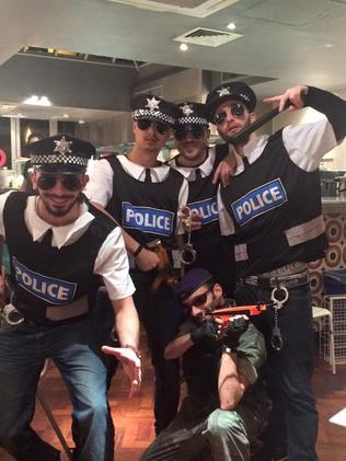 Mr Fonseca and his friends dressed up as police. Picture: Facebook