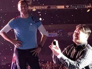 A Coldplay fan has popped the question - live on stage