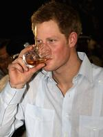 <p>Prince Harry samples the local whisky at a Jubilee Block Party in Belmopan, Belize.</p>  <p>Picture: Getty</p>