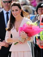 The Duchess of Cambridge receives flowers from spectators at the Playford Civic Centre. Picture: Daniel Kalisz/Getty Images