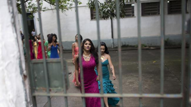 Female inmates wear evening gowns on the morning of their annual beauty contest. Picture: AP Photo/Silvia Izquierdo.