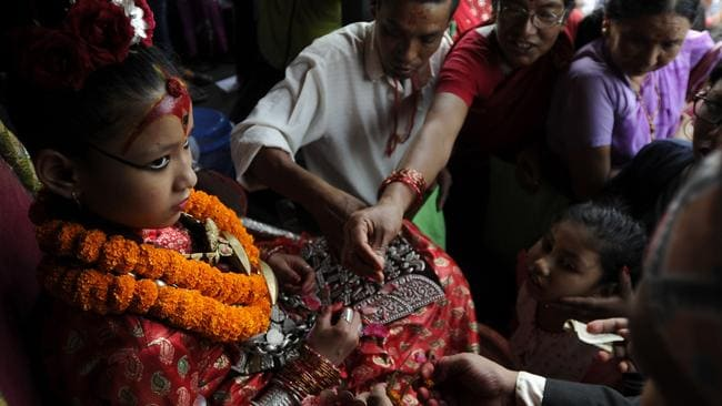 The Kumari, is considered a living goddess, and isn't allowed to leave her home unless it's for a holy ritual. Picture: AFP/Prakash Mathema