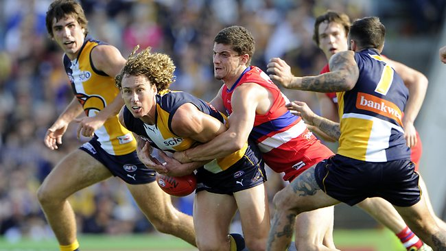 Eagle Matthew Priddis is tackled by Bulldog Tom Liberatore Picture: Daniel Wilkins