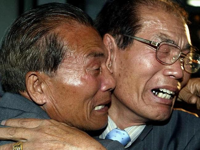 South Korean Kwon Oh-kyun, right, cries as he hugs his North Korean brother Kwon Oh-kil during a 2003 family reunion in North Korea