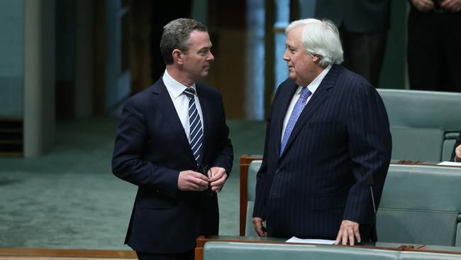 Power plays ... The Leader of the House and Minister for Education Christopher Pyne speaks to Clive Palmer as the House of Representatives considers the carbon tax repeal legislation.