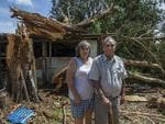 Ex Cairns to the COURIER MAIL 13.04.2014 Cyclone Ita - HOPEVALE - AFTERMATH - PICS BRIAN CASSEY 40 year Hopevale residents Elder Roy McIvor and wife Thelma beside the massive snapped tree next to their house ... it fell the right way and Thelna said it was Gods work.
