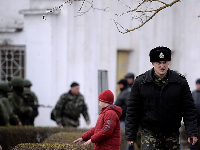 Seized...A Ukrainian officer leaves the navy south headquarters base in Novoozerne after it was taken over by Russian forces, hours after capturing the main navy headquarters in Sevastopol. Picture: AFP