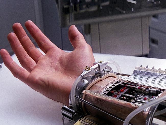 Cybernetics ... Luke Skywalker tests his prosthetic hand in Star Wars. Picture: Wookiepedia/Star Wars
