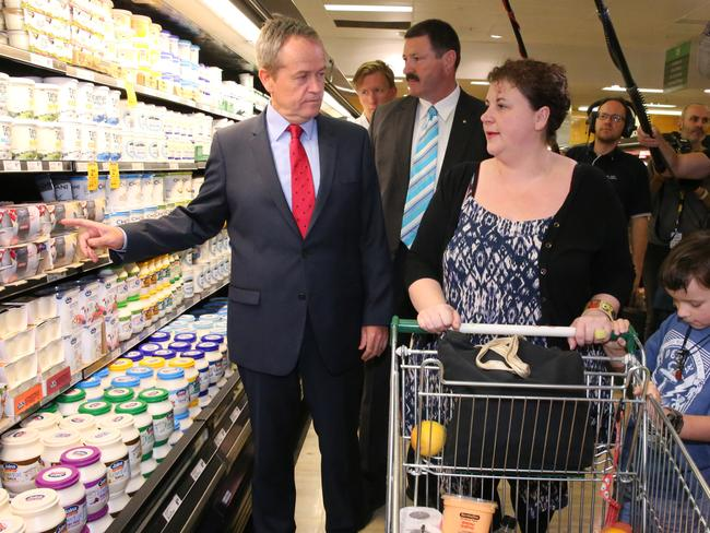 Opposition leader Bill Shorten announces Labor's fight against a GST increase as he helps the Grant family do their shopping in southern NSW. Picture: Ray Strange