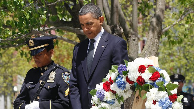 Barack Obama pauses after laying a wreath at the National September 11 Memorial in New York. Picture: AP
