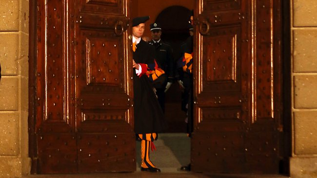 Vatican Swiss guards close the main door of the papal residence in Castel Gandolfo, south of Rome, after the end of Benedict XVI's reign. Picture: Luca Bruno