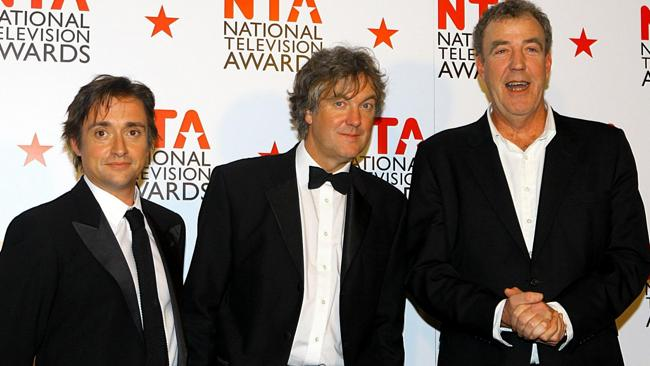Top Gear presenters Richard Hammond, left, James May, centre, and Jeremy Clarkson. Picture: AP Photo/Gareth Fuller/PA