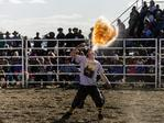 A Rodeo Clown knicknamed 'Kelpie' spits fire as part of a break in the action during the Deni Rodeo at the 2017 Deni Ute Muster on September 30, 2017 in Deniliquin, Australia. The annual Deniliquin Ute Muster is the largest ute muster in Australia, attracting more than 18,000 people to the rural town of Deniliquin together to celebrate all things Australian and the icon of the Ute in a weekend of music, competitions and camping. (Photo by Brook Mitchell/Getty Images)