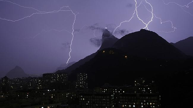 Violent ... Lightning and rain across Rio de Janeiro flooded streets and knocked out power in some neighbourhoods. Picture: AP