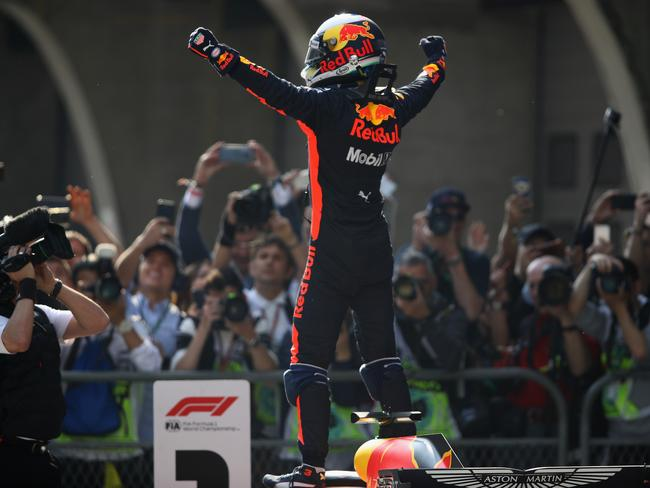 Ricciardo soaks it in after a stunning victory.