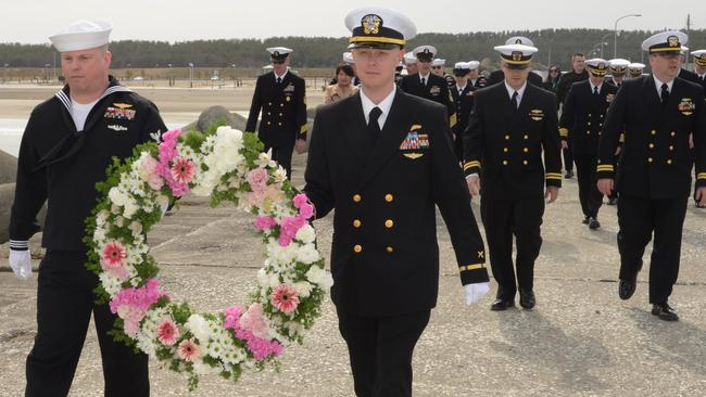 A 2013 service at a US air base in Japan to honour of the 30 Sailors and one Marine who lost their lives aboard the US Navy's EC-121 aircraft that was shot down over the Sea of Japan. Picture: US Navy