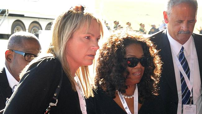 Oprah Winfrey still travels the world, even for the funeral ceremony of South African former president Nelson Mandela in Qunu this year. Picture: AFP