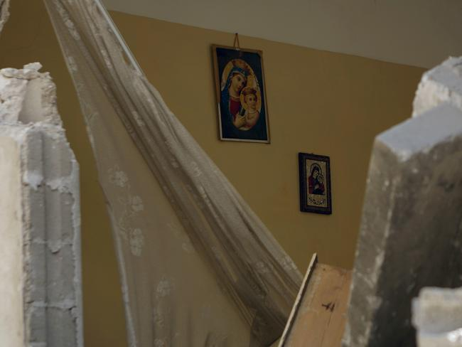 Holy war ... Images of the Virgin Mary hang on the wall of the home of Jalila Ayad, a Christian woman killed following an Israeli airstike. Picture: Mohammed Abed