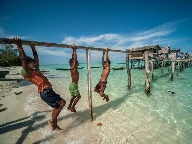 Despite their tough lives, the Bajau children of Malaysia still find time to play.