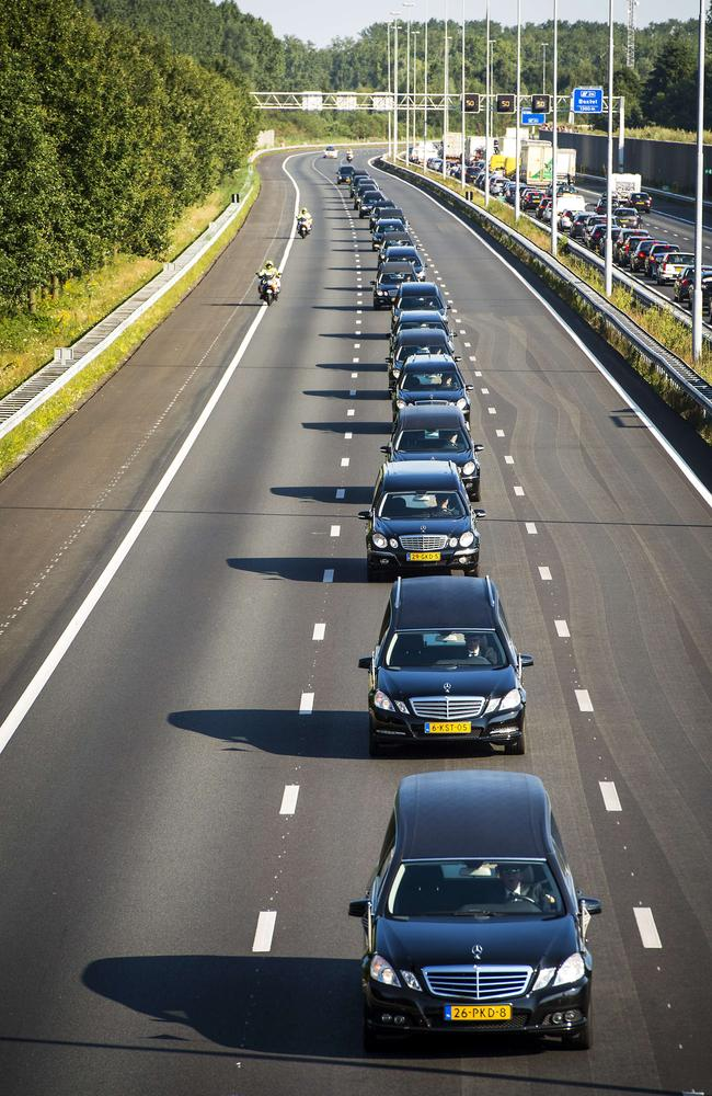 A convoy of hearses drives near Boxtel from the Eindhoven Airbase to Hilversum.