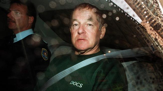 Bank robber John Killick in a police car after appearing in Sydney's Central Local Court on charges of escaping lawful custody, in May 1999.