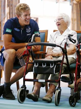 Rhys Stanley meets a fan during Geelong's 2016 community camp.