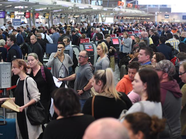 Huge queues are seen at Sydney airport after extra security measures are introduced in the wake of the terror plot. Picture: AAP Image/Dean Lewins.