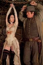 <p>Handcuffed and hanging ... Megan Fox and Josh Brolin in a scene from Jonah Hex. Picture: AP?Warner Bros</p>