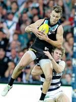 Round 6: Robbie Gray marks in front of Cameron Guthrie. Picture: Sarah Reed