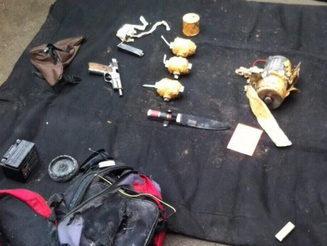 A backpack, handgun, knife and improvised explosives recovered from the scene of the terrorist attack on downtown Jakarta. Picture: TWITTER @KompasTV
