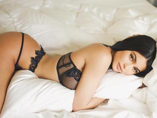 Like the rest of us, Kylie Jenner lounges around in bed with a face full of make-up, sexy expensive lingerie and not a hint of bum crack... Picture: Kylie Jenner / Instagram