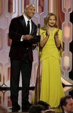 In this image released by NBC, Dwayne Johnson, left, and Jennifer Lopez present an award at the 73rd Annual Golden Globe Awards at the Beverly Hilton Hotel in Beverly Hills, Calif., on Sunday, Jan. 10, 2016. (Paul Drinkwater/NBC via AP)