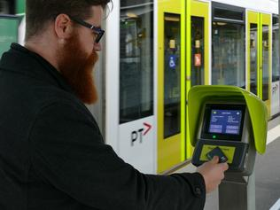 A new myki Quick Top Up machines in action at Domain Interchange.