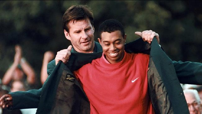 NICK Faldo and Tiger Woods at the US Masters. Faldo criticised Woods for not diqualifying himself at the 2013 event.