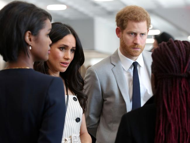 Harry and Meghan talking with delegates. Picture: AFP