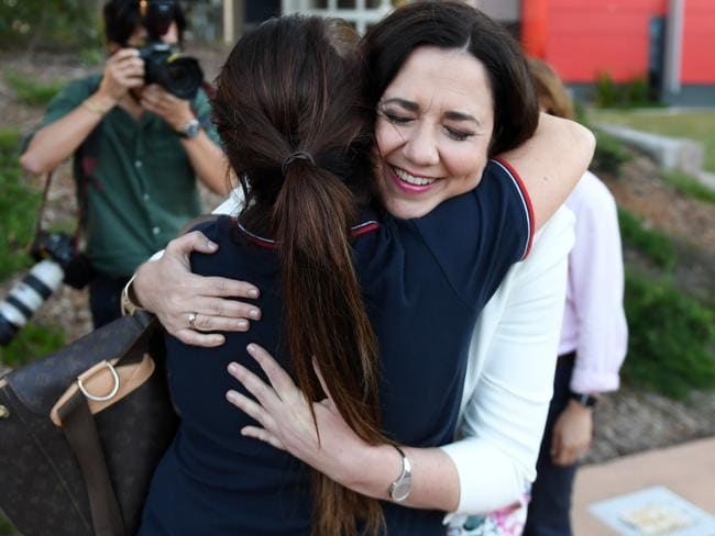 Queensland Premier Annastacia Palaszczuk hugs a nursing staff member outside the Gold Coast University Hospital on the last day of the campaign.