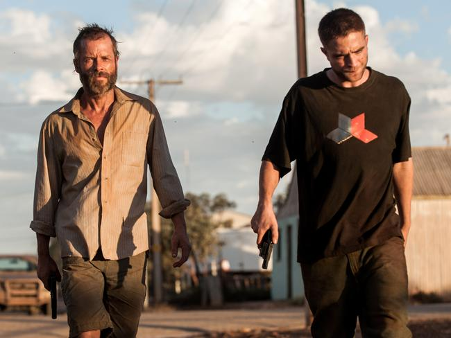 A law unto themselves ... Guy Pearce and Robert Pattinson in  <i>The Rover</i>.