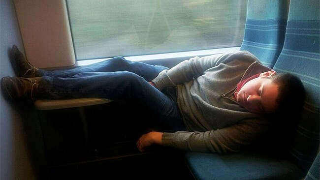 Tray tables become leg rests. Picture: SleepyCommuters/Twitter