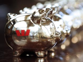 The Westpac Banking Corp. logo adorns the piggy banks on display at a branch in Sydney, Australia, on Wednesday, Nov. 4, 2009. Westpac Banking Corp. said second-half profit fell 10 percent, less than analysts expected, as the lender joined Australia & New Zealand Banking Group Ltd. in saying bad debts have peaked as the economy recovers. Photographer: Ian Waldie/Bloomberg