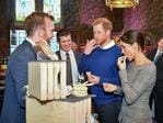 Britain's Prince Harry and his fiancée Meghan Markle taste traditional Welsh cakes during a visit at Cardiff Castle in Cardiff, south Wales on January 18, 2018, for a day showcasing the rich culture and heritage of Wales. Picture: AFP