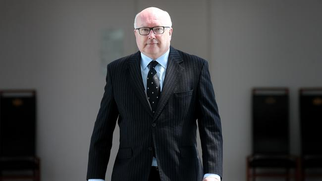 "Attorney-General Senator George Brandis said he had an ""entirely open mind"" on changes to the courts' structure."