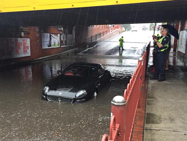 A Maserati that was flooded after the driver attempted to navigate a flooded underpass at Victoria Street in Seddon, Melbourne on Saturday. Picture: AAP Image/Supplied/Sarah Schubert