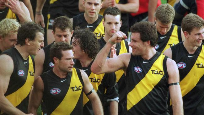Matthew Richardson walks off with his Tiger teammates — including current club CEO Brendon Gale on the left — after Richmond's 2001 semi-final win against Carlton.