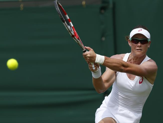 Stosur hits a double-handed backhand to Wickmayer.