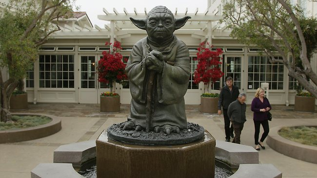 People walk past a fountain showing the Yoda character from the Star Wars movies outside of Lucasfilms headquarters in San Francisco. Picture: Jeff Chiu