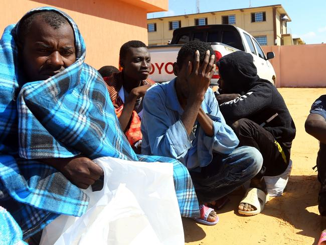African migrants, whose boat sank off the Libyan coast, gather at the Tripoli branch of the Anti-Illegal Immigration Authority. Picture: AFP/Mahmud Turkia